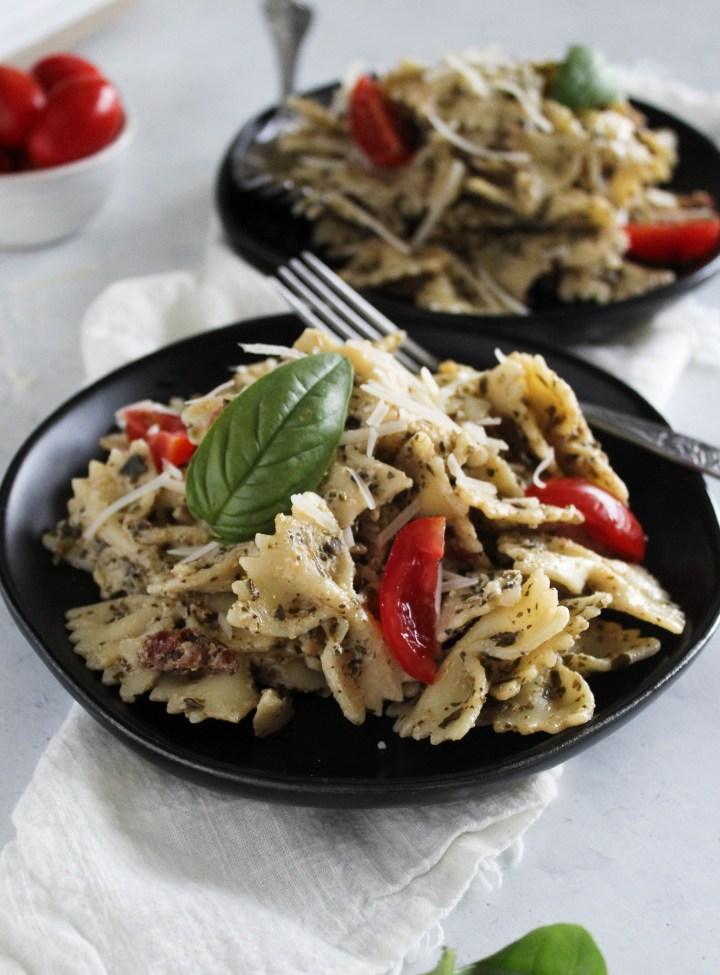 Pesto pasta in plates.
