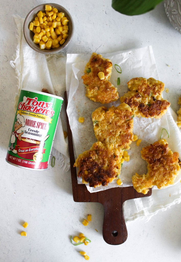 jalapeno corn fritters pictured with Tony Chachere's seasoning