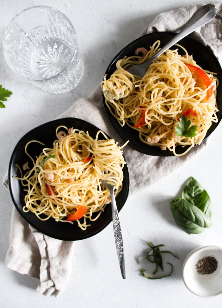 overhead view of summer shrimp pasta with forks in plates