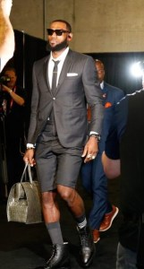 Fashionable Lebron James, suit with shorts and purse