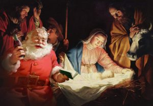 Santa drinking Coca Cola in the manger