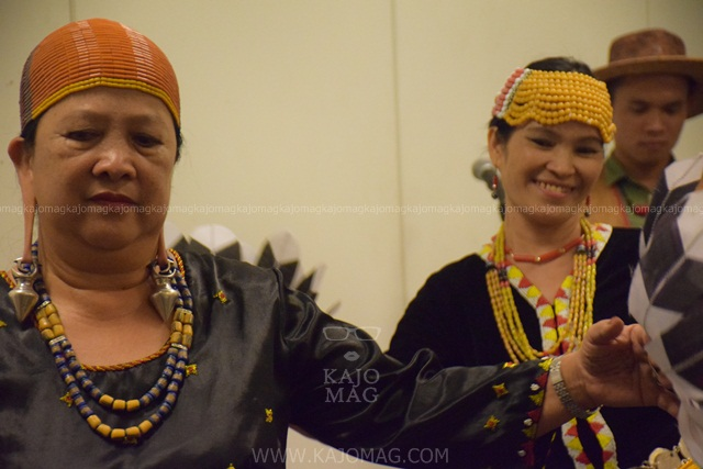 Kelabit women donning traditional Kelabit costume and headgear