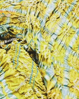 yellow gajisilk gharchola bandhani saree