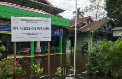 Untuk Sementara Puskesmas Purnama tidak dapat layani pasien akibat banjir