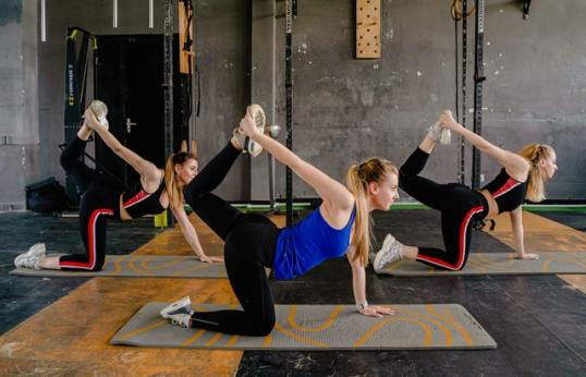 Stretching in a Class. Image by Anthony Shkraba.