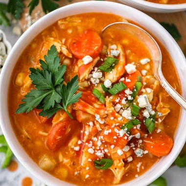 This easy crock pot buffalo chicken soup is full of spicy buffalo flavor and loaded with veggies too! Plus it's also dairy free and gluten free.