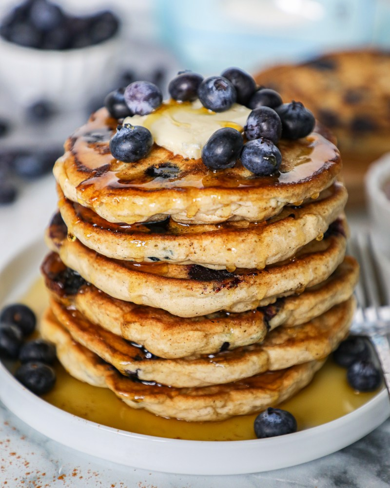 Warm delicious blueberry pancakes that are so soft and fluffy! You'll be flying out of bed for these in the morning!
