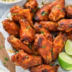 Healthier chicken wings that are baked in the oven and then slathered with a delicious 3 ingredient mango bbq sauce!