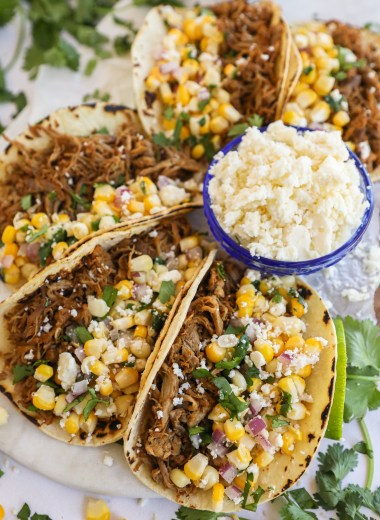 Healthy and delicious pork carnitas tacos made in the slow cooker! They're tender, moist and full of so much flavor!