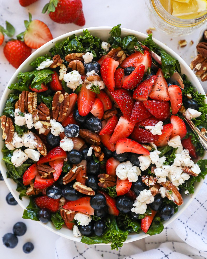 A healthy and refreshing side salad made with strawberries, blueberries, goat cheese, toasted pecans and an easy lemon poppy seed dressing! It's the perfect salad for summer!