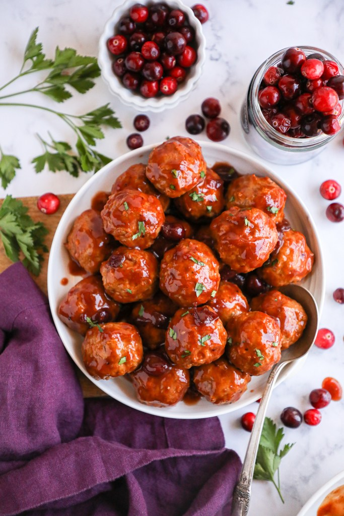 These simple and delicious meatballs are perfect to serve for a crowd! Just place them in a crockpot, pour your sauce over the top and they're ready for your next holiday gathering!