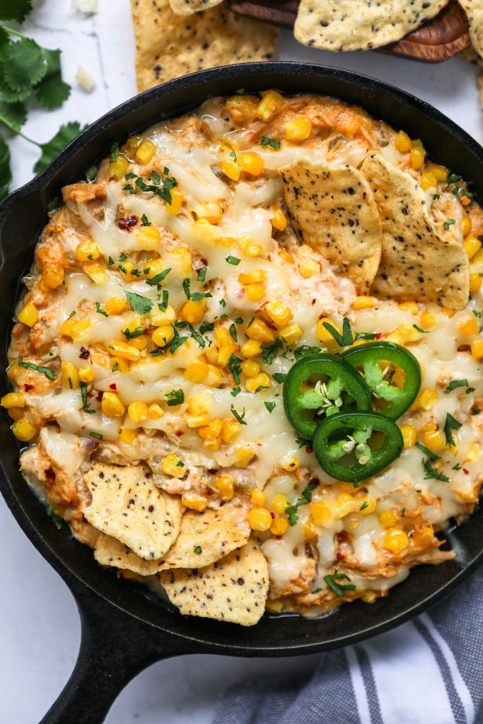 This lightened up dip recipe is made with shredded chicken, sweet corn, green chile and soo much gooey cheese! Your guests are going to love it!