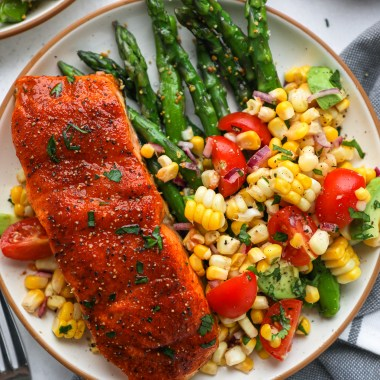 An easy salmon recipe made with coconut sugar, paprika, salt, pepper and a squeeze of lemon. It's sweet, a little spicy and perfect for a quick weeknight meal!