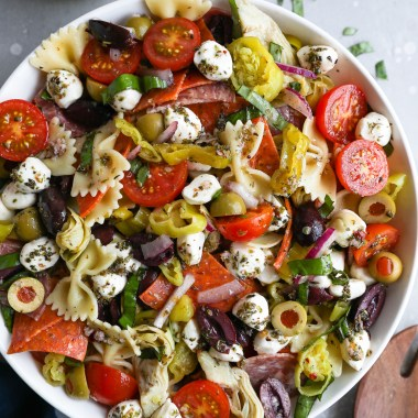 A large white bowl filled with antipasto pasta salad