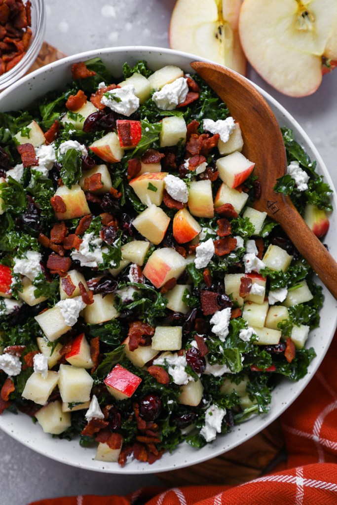 Close up of an apple and cranberry kale salad