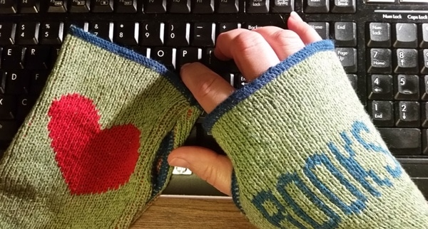 Fingerless gloves on keyboard