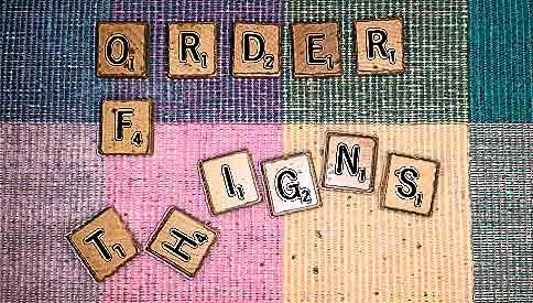 scrabble tiles spell order of t-h-i-g-n-s