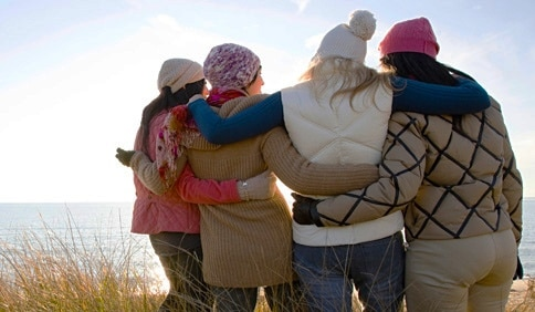 women hugging in friendship