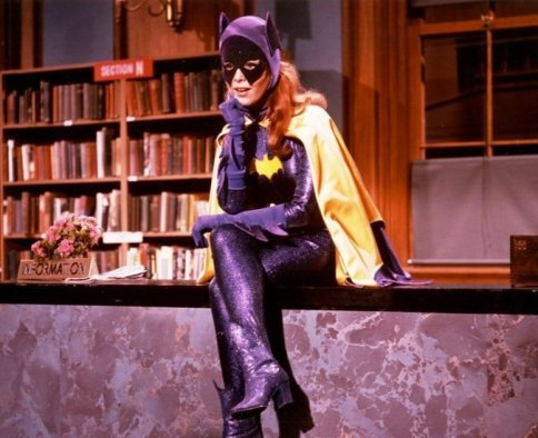 Batgirl from 1966 series sits on library desk
