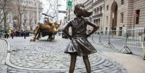 statues fearless girl with charging bull