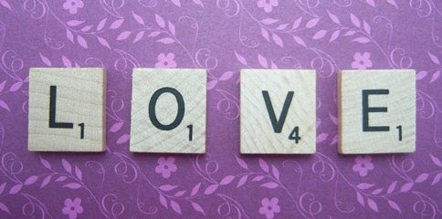 love spelled in scrabble tiles