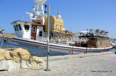 A fishing boat geared and ready for the day of fishing in Paros.