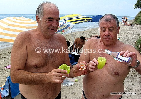 Yiannis (left) and Giorgos (right), sipping Ouzo out of cups made from peppers