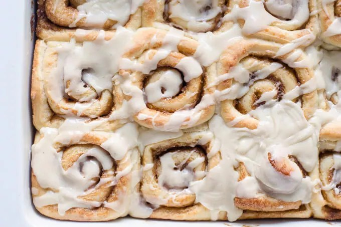 Pan of frosted eggnog cinnamon rolls