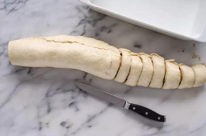 log of dough, sliced