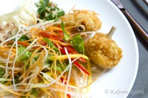 Green papaya salad with spicy chicken nuggets
