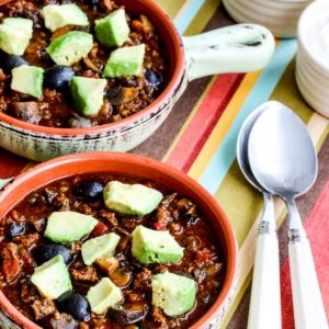 Beef Chili with Sausage, Mushrooms, and Olives close-up photo