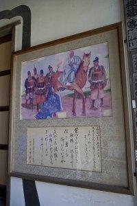 日蓮に牡丹餅を差し出す桟敷尼の絵が飾られています。
