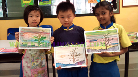 Students with their artworks
