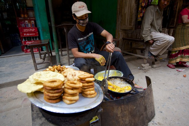 A street vendor cooking up a storm for breakfast along one of the many side streets in downtown Kathmandu.