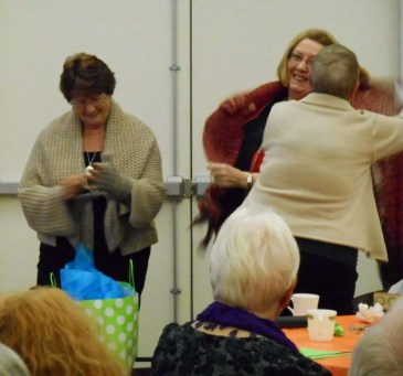 "Phyllis and Ruby are thanked for all their work in ""sales"" of the housing project. The prayer shawl ministry group presents them each with a shawl."