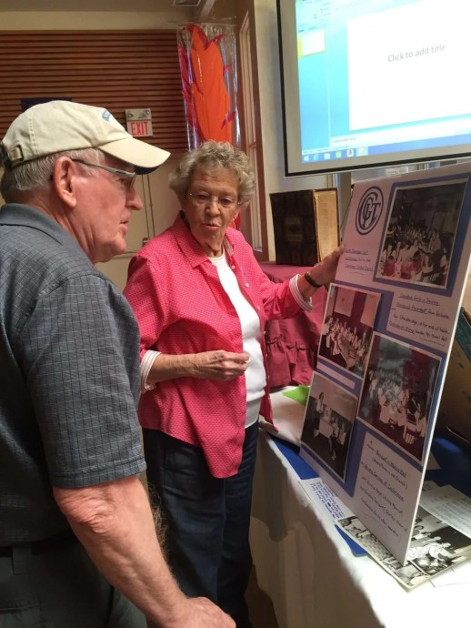 Ray and Bonnie look over the CGIT memorabilia.