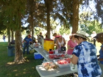 Enjoying a picnic lunch & visiting.