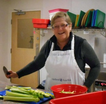 Francelyn prepares the veggie sticks (and lots of other chores).
