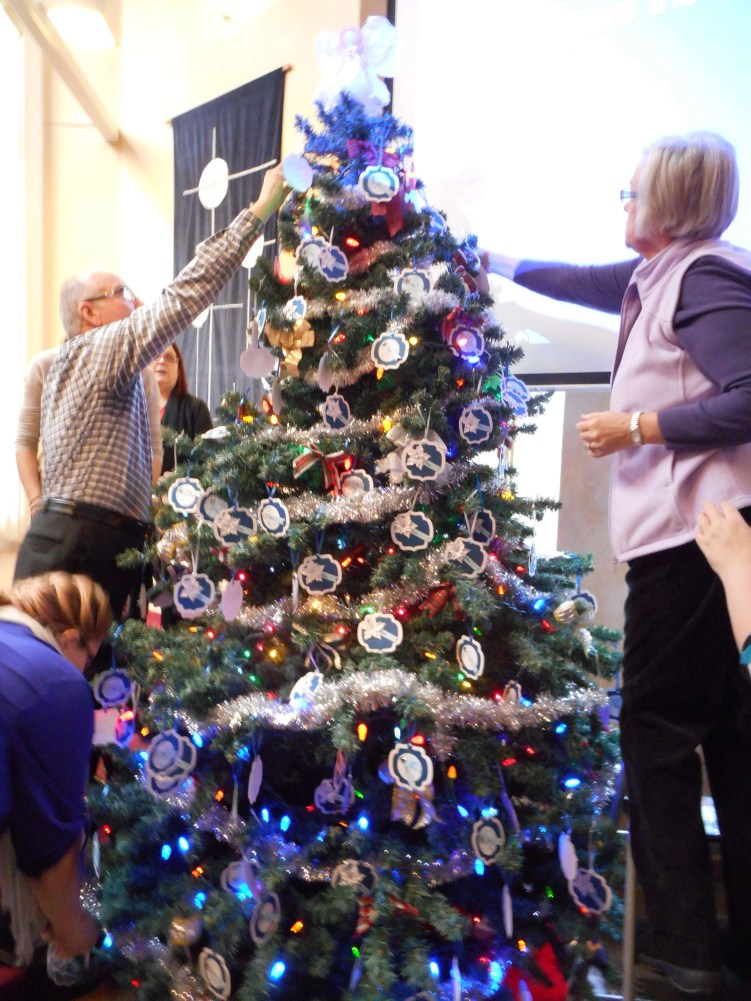 The congregation places their prayers of hope on the Advent Tree.