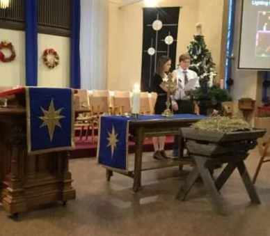 Grace and Jared lighting the advent candles and the Christ candle
