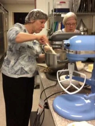 June and Carol mixing up more batches of dough.