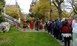 Preparing to enter the welcoming circle, cleansed by cedar boughs.