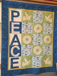 The Peace quilt graces our space.