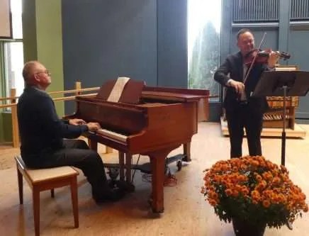 Tomas and his father offer some beautiful music for the live-stream/zoom memorial service.