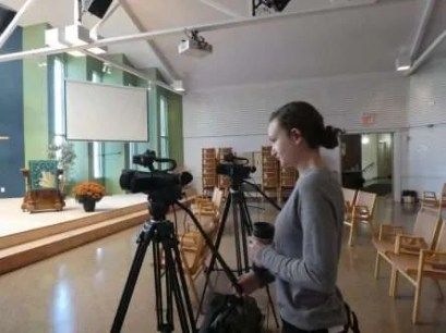 Joanna operating the cameras at our first zoom memorial service from KUC