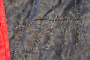 """<Alt=""""Elven runes in stitching"""">"""