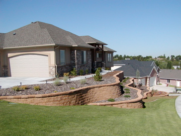 Curved, tiered retaining walls