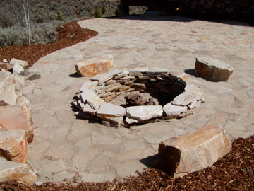 Stone firepit with stone seats and patio