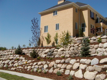 Tiered rock retaining walls