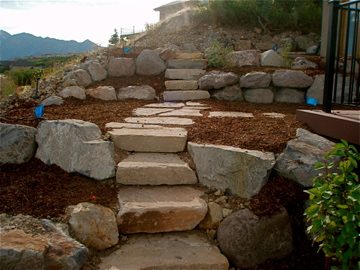 Large stone stairs and retaining walls